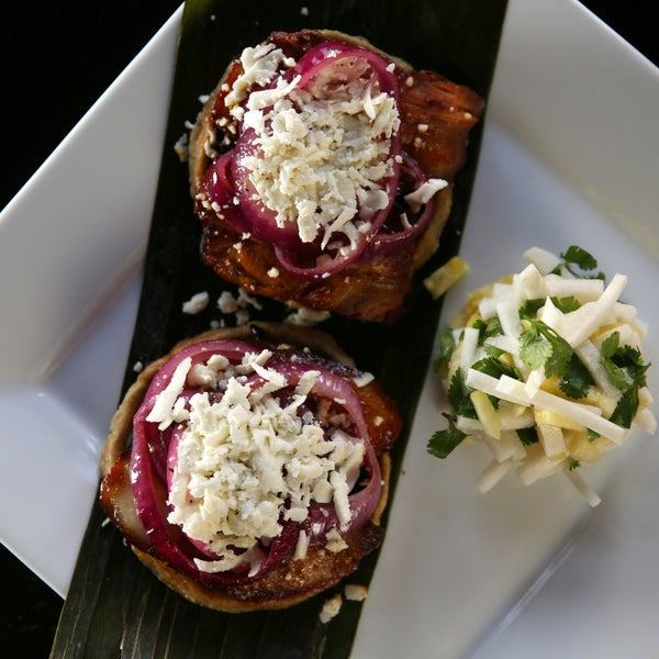 The standout dish here is the sopes de panza (belly in Spanish). Capture the full experience by trying one of the house cocktails, like the Mezcal Mula.