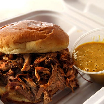 This fast-casual barbecue joint — open during breakfast and lunch only Monday through Friday — specializes in a bright, yellow sauce, honey mustard-like in color and flavor.