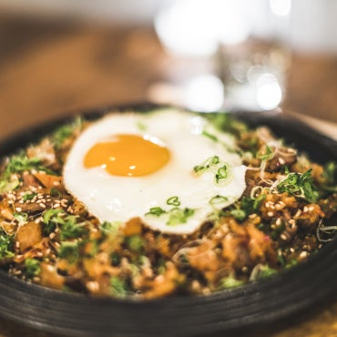 This Korean joomak delivers exactly what NYC's nocturnal gastronauts crave most: a new & exciting way to drink & eat at the same time. Order a fiery communal bowl of the late-night-only Korean ramen.