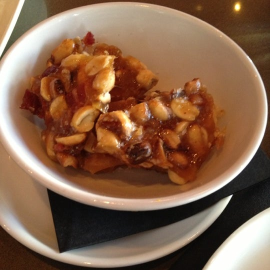 Try the bacon peanut brittle & pair it with one of the many beers on tap.