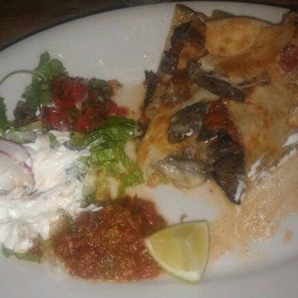 Foto tomada en Lolita Cocina & Tequila Bar por Erin S. el 6/23/2012