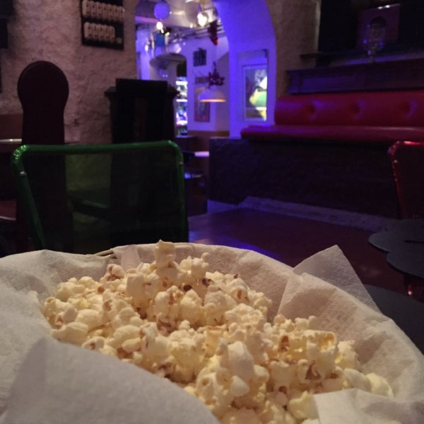 Popcorn to go with the drinks and a good tasting amaro, with a funky decor.