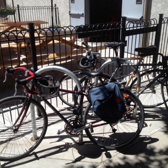 Photo taken at Denver Bicycle Cafe by Tim J. on 6/9/2012
