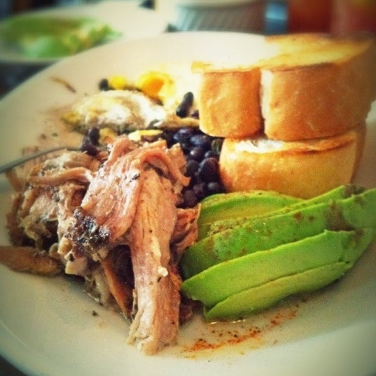 The Lechon Asado is some of the best slow roasted pork I've ever tasted, served with avocados topped w/ lime juice and chili powder, two eggs, beans, and toast.
