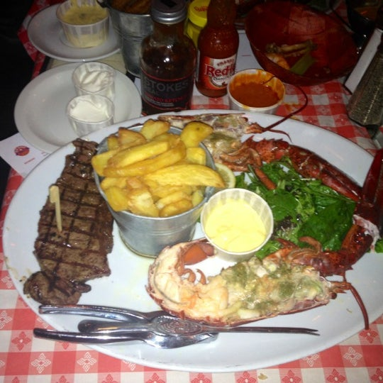 Foto tirada no(a) Big Easy Bar.B.Q & Crabshack por Natasha A. em 6/7/2012