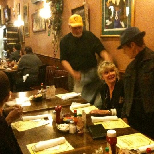 Photo taken at Mandina's Restaurant by Gini C. on 1/16/2012