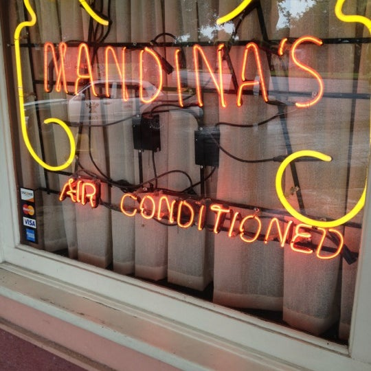 Photo taken at Mandina's Restaurant by Paul N. on 7/7/2012