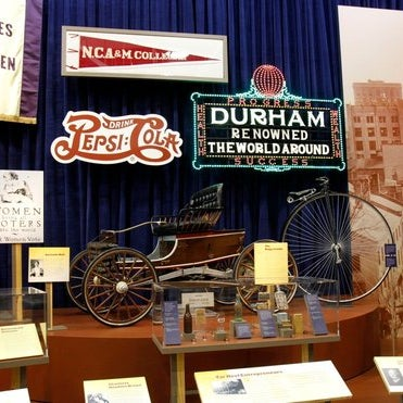 Things that fit inside the new exhibit, its largest ever: Two full-size houses, authentic tobacco & textile mill façades, multiple tractors and a scale replica of the Wright brothers' flying machine.
