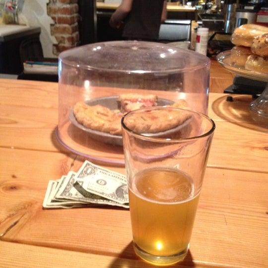 Photo taken at Denver Bicycle Cafe by Tim J. on 3/28/2012