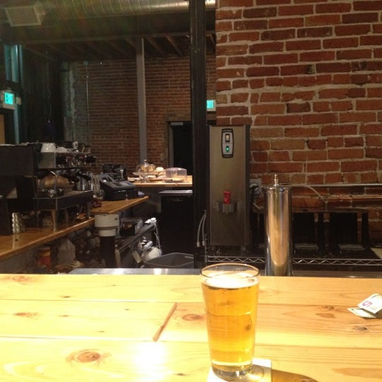 Photo taken at Denver Bicycle Cafe by Tim J. on 5/2/2012
