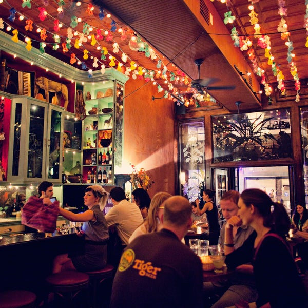 Get cozy in a velvet booth at this mescal bar adorned with folk art, statuettes, masks and other mementos of the co-owners' travels. Taste the namesake spirit in a flight of three one-ounce pours.