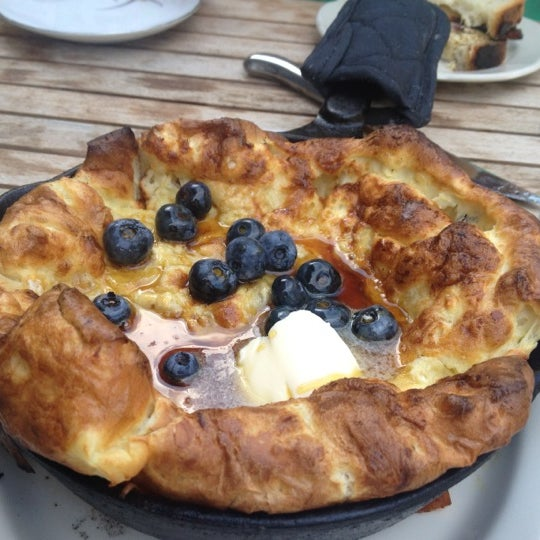 What's not to like about a puffy pancake that comes in a still sizzling skillet? Like a cross between a pancake and a popover. Comes with some stewed blueberries and buttah on top..