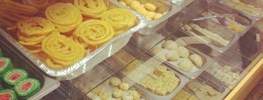 Surati Farsan Mart is one of สถานที่ที่ Laura ถูกใจ.