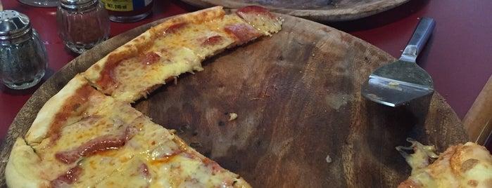 Happy's Pizza is one of Locais curtidos por Pablo.
