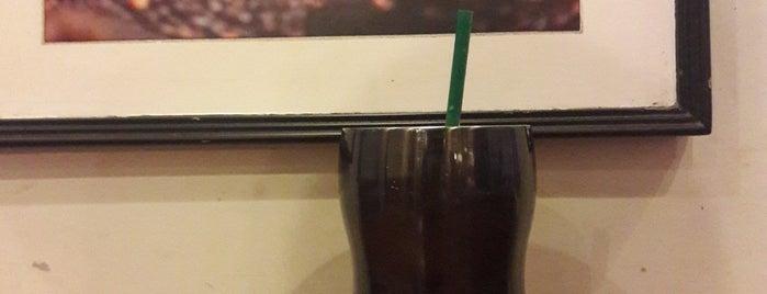 Starbucks is one of Lugares favoritos de Nin.