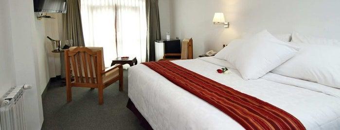 Hotel Hacienda Plaza de Armas is one of Tempat yang Disukai Marcus.