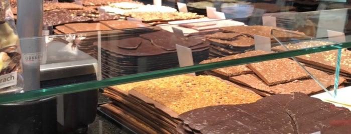 Läderach chocolatier suisse is one of Locais curtidos por Khalid.
