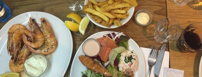 The Seafood Bar is one of Tempat yang Disukai Irina.