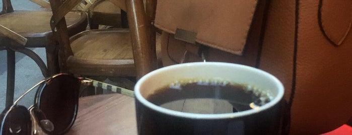 a cup of peaberry is one of Locais curtidos por Ozlem.