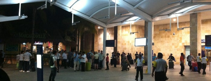 Transitzone Cancun Airport is one of Tempat yang Disukai Andrea.