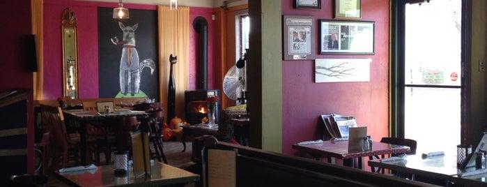 White Dog Black Cat Cafe is one of Locais salvos de Phil.