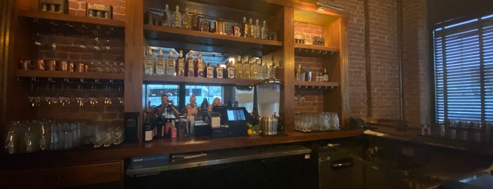 Tom's Town Distilling Co. is one of KC Q and Brew.