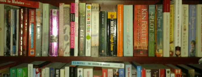 Treehugger Dan's Bookstore Cafe & Lounge is one of Books everywhere I..