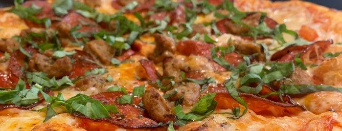 Stouts Pizza Co is one of Ron'un Beğendiği Mekanlar.