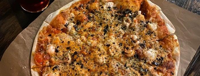 Camorra Pizza e Birra is one of Locais curtidos por *****.