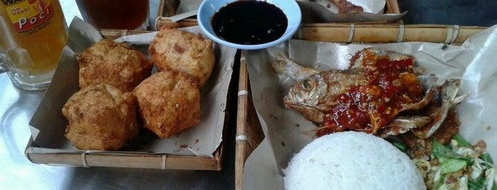 Ayam Penyet Suroboyo is one of Malang Food.