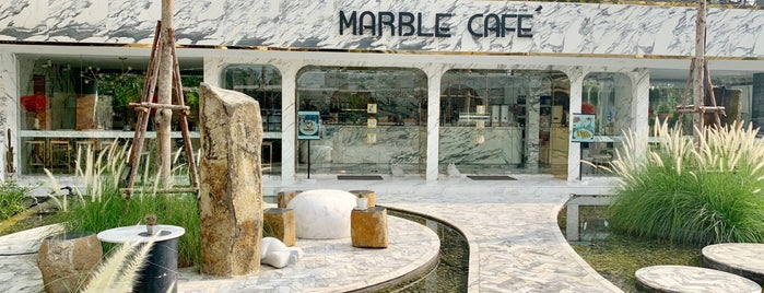 Marble Café is one of Lieux qui ont plu à Huang.