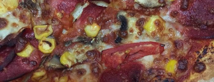 Domino`s pizza ugur mumcu is one of Tempat yang Disukai Melih.