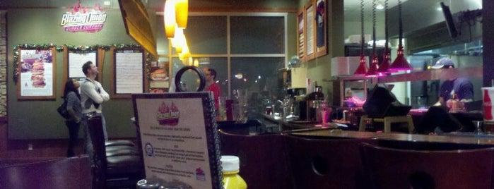 Blazing Onion Burger Company is one of Tempat yang Disukai Kevin.