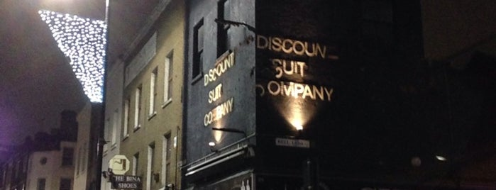 Discount Suit Company is one of i like london in the rain.
