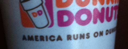 Dunkin' is one of Locais curtidos por Brady.