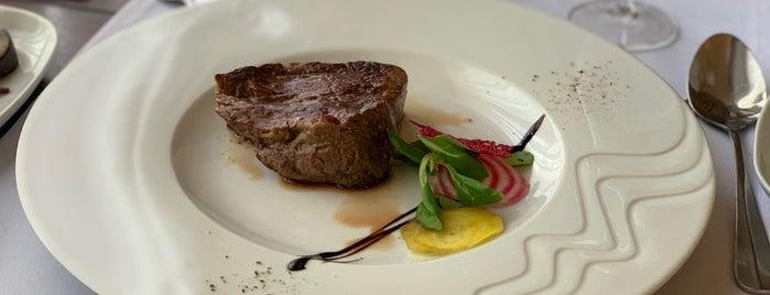 Muzika Restaurant is one of Locais curtidos por P.