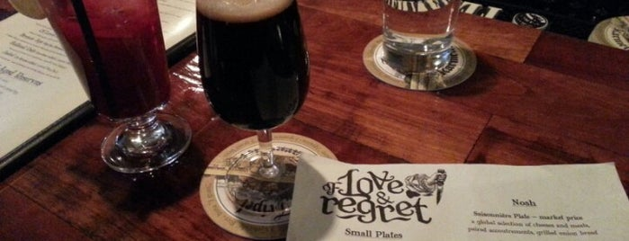 Of Love & Regret is one of Baltimore Sun's 50 Best Bars (2013).