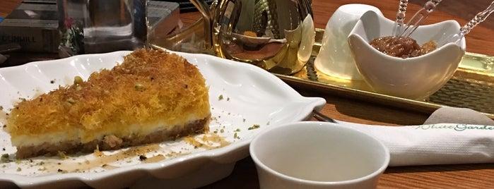White Garden Cafe is one of Madawi: сохраненные места.