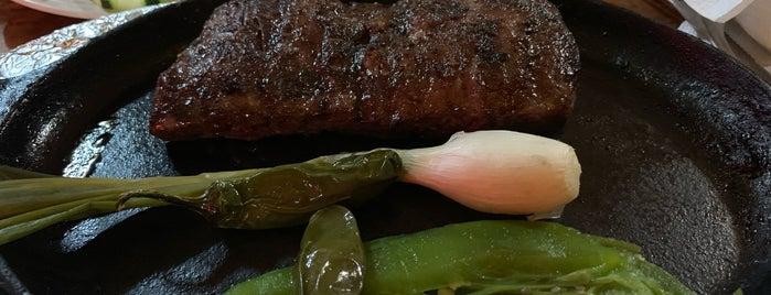 Los Pioneros Steak is one of Lieux qui ont plu à Carlos.