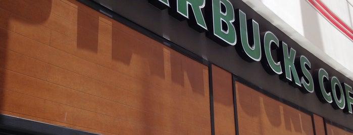 Starbucks is one of Lieux qui ont plu à Lou.
