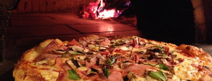 Pizzeria Romas is one of Lugares guardados de Ifigenia.