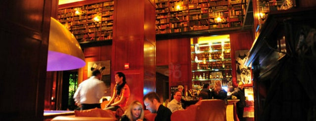 The Library at Hudson Hotel is one of 10 of NYC's Best Bars with Books.