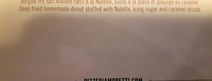 Pizzeria Moretti is one of Restos.