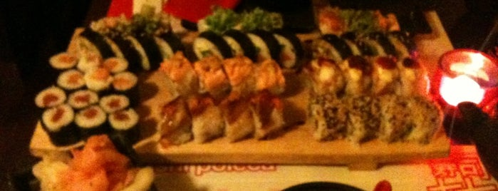 77 Sushi is one of Marta's Liked Places.