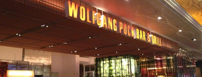 Wolfgang Puck Bar & Grill is one of pizza places of world 2.