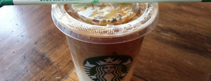 Starbucks is one of Lieux qui ont plu à Charles.