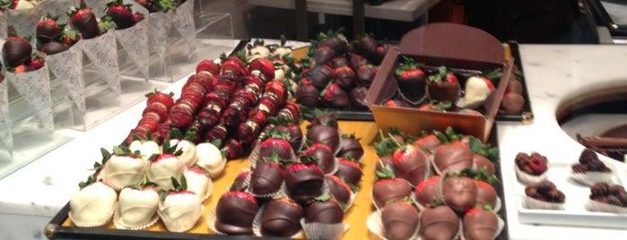 Godiva Chocolatier is one of Lieux qui ont plu à Soneya.