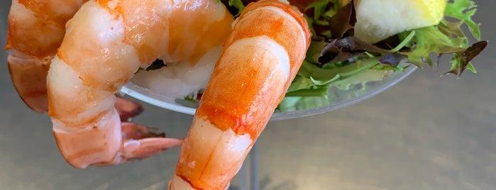 Big T Seafood Market Bar is one of Lieux sauvegardés par Tan.