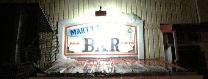 Marty's Bar is one of Lugares favoritos de Kyle.