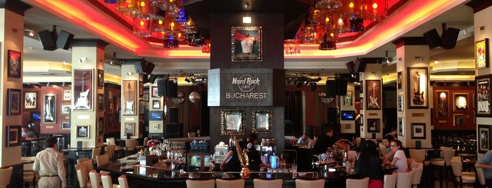 Hard Rock Cafe București is one of Lieux qui ont plu à Jon.